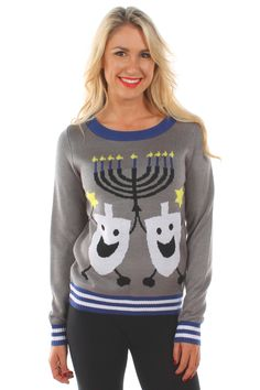 It's Hanukkah season, and what better way to celebrate that with a holiday sweater? This soft, blue grey garment is livened by a pair of dancing dreidels.