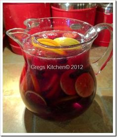 Christmas Sangria Recipe:  ■1 lemon   ■1 lime   ■1 orange   ■1/2 cup blueberries (frozen is fine)   ■1 cup strawberries (frozen is fine)   ■1 1/2 cups rum   ■1/2 cup simple syrup (or 1/2 cup sugar)   ■1 (750 milliliter) bottle dry red wine   ■1/2 cup orange concentrate   ■cinnamon for topping the drinks   ■candy cane for stirring     This one is  a hard one……… Cut and add fruit to pitcher plus all other ingredients, stir, pour, DRINK! :) YUM!