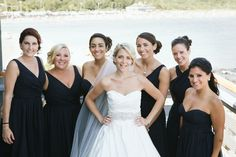The girls looked stunning in mismatched, navy bridesmaid dresses. | An East Coast Wedding in Mismatched Bridesmaid Dresses