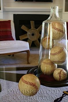 Balls: Capture marbles, balls or child-like games in a glass container to showcase color and creativity. Vintage baseballs convey a sporty look for living areas of the home. Stacks several like items under glass to serve as a centerpiece to your room.