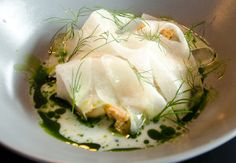 From Radio restaurant in Copenhagen by Chefs Jesper Kirketerp and Rasmus Kliim: scallops with buttermilk, drops of dill oil, bread croutons, topped with thinly sliced kohlrabi, a type of cabbage, and dill.