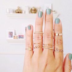Turquoise nails + stacked rings