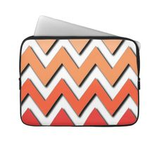 Unique, trendy and pretty laptop protection sleeve. Bbeautiful, modern and funky poppy red, pastel and peach orange ombre colored aztec chevron zig zag stripes pattern. Colorful vintage retro style zigzag design for the fashionista and fashion diva, the hip trend setter, modernism, nouveau deco art or the mod motif lover. Cute and fun birthday gift or Christmas present. Elegant, classic, chic, original and cool protective laptop sleeve for the classy and sophisticated business man or woman.