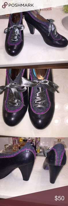 """Poetic License Backlash Black Booties Poetic License London a design Asylum creation brand. Style Backlash Black # M070. Size 7 M Ankle Booties with 3 1/4"""" heel. Shiny Black Leather upper shoe. Opening of shoes fabric lined with purple suede scallop trim and rubber soles. Green ribbon laces makes this simply elegant. Booties in great condition. Purchased new on sale from Nordstrom for $100 reduced from $129. Research this brand/shoe. This is a great price! Poetic License Shoes Ankle Boots…"""