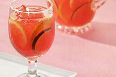 This fruity, refreshing mock sangria is made with raspberry drink mix and white grape and orange juices and garnished with lemon, lime and orange slices.