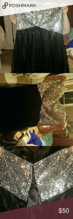 Floor legnth prom/ Special occasion dress Has a fully jewled bustier ive never worn it out i got it for prom and it wasnt the right size. Has a corset back will take more pics if you want. Dresses Prom