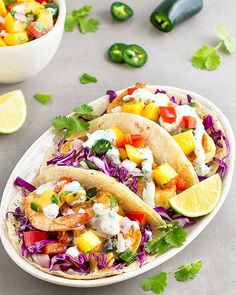 Spicy shrimp tacos with mango salsa and cilantro lime sauce. An easy, flavorful and delicious meal ready in 20 minutes! Cilantro Shrimp, Grilled Shrimp Tacos, Shrimp And Quinoa, Cilantro Lime Sauce, Shrimp Recipes, Mexican Food Recipes, Healthy Recipes, Mexican Dishes, Detox Recipes