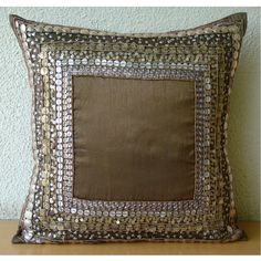 Ethnic Origins - Throw Pillow Covers -16x16 Inches Brown Silk Dupion with Antique Accents. $29.50, via Etsy.