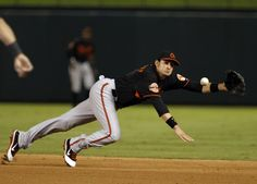 Baltimore Orioles second baseman Ryan Flaherty can't stop a single by Texas Rangers' Michael Young during the fourth inning of an American League wild-card playoff baseball game Friday, Oct. 5