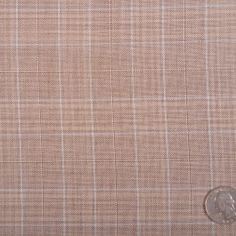 This is a light weight, smooth-handed, wool plaid. Great for spring and summer suiting.