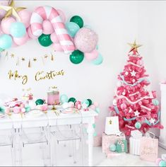 Sugar plums will be dancing in their heads once they see this adorable Sugar Plum Fairy DIY Balloon Garland. Each garland includes 6' of balloon tape, instructions, 1 jumbo pink/white candy cane foil balloon, 2 gold paper stars, and biodegradable latex balloons in various sizes in shades of pink, mint, and emerald green. Christmas Balloons, Pink Christmas Decorations, Merry Christmas Banner, Christmas Gift Bags, Christmas Gift Wrapping, Christmas Paper, Christmas Candy, Christmas Items, Christmas Feeling