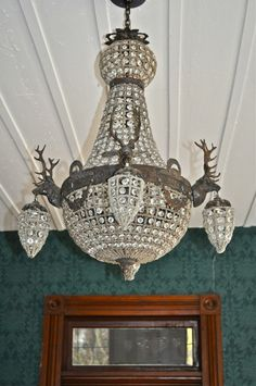 Crystal stag chandelier in living room of Meadow Manor Cottage.  I am now the proud owner of one myself!