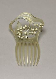 René Lalique - Art Nouveau Hair Comb. Carved Mother of Pearl and Silver. France. Circa 1900.