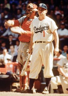 Pee Wee Reese looks for the sign.