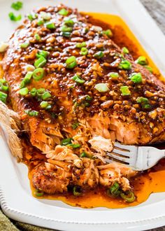 Firecracker Baked Salmon with Salmon Fillet Green Onions Garlic Fresh Ginger Olive Oil Soy Sauce Brown Sugar Crushed Red Pepper Flakes Sriracha Sauce Ground Black Pepper. Salmon Dishes, Fish Dishes, Seafood Dishes, Seafood Recipes, Cooking Recipes, Healthy Recipes, Best Fish Recipes, Meal Recipes, Recipes With Hot Sauce
