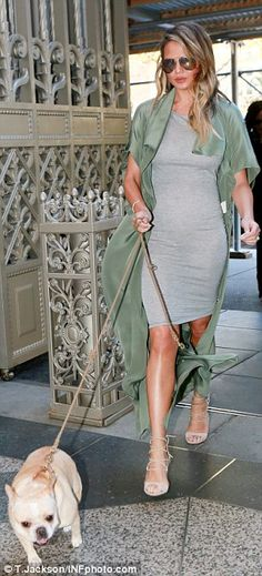 Looking good: Along with the bodycon dress she sported an olive green kimono jacket and st...