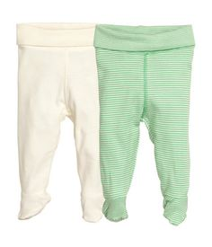 H&M baby 2-pack Tights $12.99 CONSCIOUS. Footed tights in soft, organic cotton jersey with wide foldover ribbing at waist.