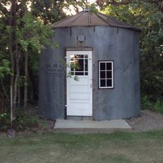 Grain silo bin repurposed into shed. This is so cool. I need this for my work studio with a fireplace in the centre.