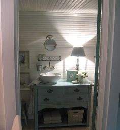 Bureau color with white vessel sink