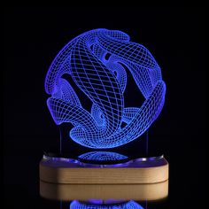 This LED Illusion Crystal Ball Lamp resides somewhere between work of art and functional lighting fixture. Made from custom-engraved acrylic and a solid pine base, both parts are machined with Blue Pine's own CNC milling machine, then sanded and coated for maximum visual impact.