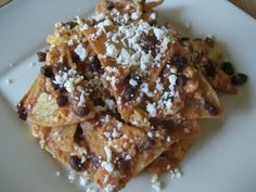 Chilaquiles...these have scrambled eggs! YUM! a mix of my mom and his moms