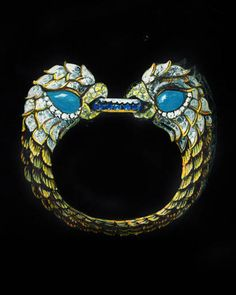 A David Webb double-headed Parrot bracelet in platinum, 18k yellow gold, diamond, turquoise and sapphires, circa 1965.