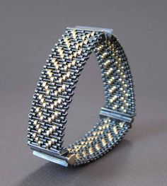 Bracelet | Hanne Behrens. 'Triangle' Woven fine silver and 750 gold