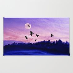 Crow moon Area & Throw Rug by Pirmin Nohr - $28.00 A flock of crows flying through a foggy valley at dawn. That tower on the mountain is a castle ruin. A photomontage of 4 of my pics.   Nature, landscape, valley, silhouettes, fog, castle ruin, sky, clouds, red, blue, black, mystical, birds, animals, fullmoon, moon
