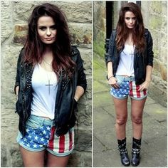 usa flag denim shorts, white tee, black studded leather jacket and combat boots outfit