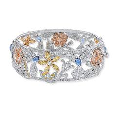 Garrard Bangle  Sapphires and diamonds in gold