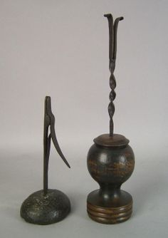 Pair of early wrought iron and wood rushlights. google.com