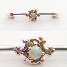 "14g industrial barbell with 14K rose gold ""Milano"" Paloma swirl center piece and 14K rose gold white opal bullet cut ends."