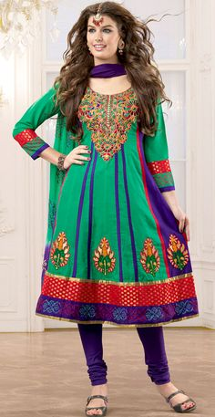 It is color this season and bright shaded suits are really something that is totally in vogue.   The dazzling green and purple cotton anarkali churidar suit have amazing embroidery patch work is done with resham work.   Beautiful embroidery work on kameez is stunning.   The entire ensemble makes an excellent wear.   Matching purple cotton churidar and shaded dupatta is available with this suit.   Slight Color variations are possible due to differing screen and photograph resolutions.