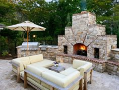 outdoor kitchen design with cool fireplace