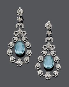 <B>AQUAMARINE AND DIAMOND EARCLIPS.</b></i><br>Platinum 950.<br>Each set with 1 aquamarine briolette of ca. 18 x 12,6 x 7,7 mm, within a floral frame set with brilliant-cut diamonds, weighing ca. 3.00 ct. L ca. 7 cm.