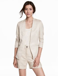 Check this out! Fitted jacket in woven fabric. Gathered 3/4-length sleeves, welt front pockets, and no buttons. Lined. - Visit hm.com to see more.