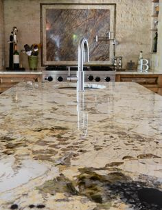 Alpinus kitchen (Levantina Dallas). This beautiful exotic granite is used on the kitchen island and countertops.