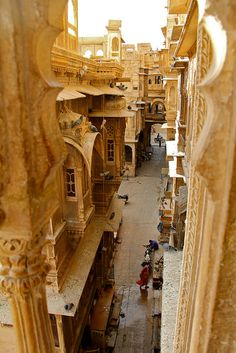 """Ancient city streets of Jaisalmer in Rajasthan, India. Known as """"Golden City"""" because of its forts and temples built with yellow sand."""
