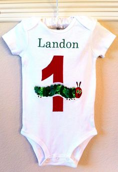 Too expensive but SOO Cute: Very Hungry Caterpillar Birthday Bodysuit with Monogram. $20.00, via Etsy.