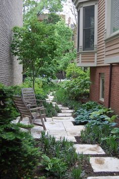 Meandering Paver Stone Path with Evergreens, Hostas, Liriope, and Teak Chairs