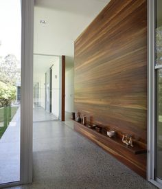 inside entry way leading to bedroom? wood clad wall in hallway