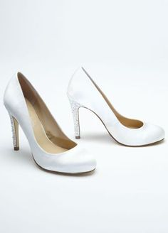 """Step out on town with a pump that will give you that extra sparkle to really make you shine!  High heel round toe pump features a stylish and unique crystal embellished heel.  Heel measures: 4"""".  Fabric content: Satin upper with a leather sole.  Available in: white.  Imported."""