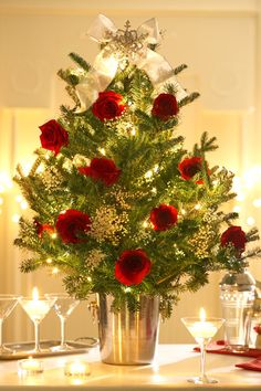 Roses and Elegance Add to a holiday party by placing a fresh cut tree into a silver ice bucket and dressing it with lush velvety red roses and delicate baby's breath.
