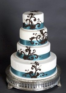 Classic White Wedding Cake with Chocolate Scrollwork - Here is something I love. Taking a classic cake and giving it a little bit of pizazz! I love how this cake is a simple four tiered round cake with a gorgeous slate blue sash around the base of each tier. Beautiful and classic yes?