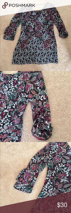 Floral Print Dress Lovely flowing long sleeve dress with option to wear long or tied for 3/4 length sleeves. Easy care machine washable. NWT. Never been worn. Speechless Dresses