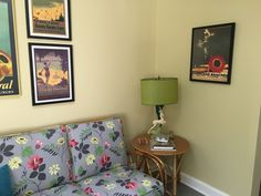 Renovated sunroom with Heywood-Wakefield sectional & side tables. Adorable gazelle table lamps.