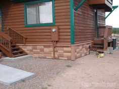 Fake rock wall paneling on a log cabin-style building