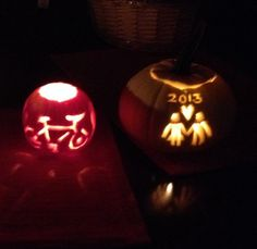 Newly wed pumpkin carving for Halloween. White pumpkin with wedding date on three week anniversary