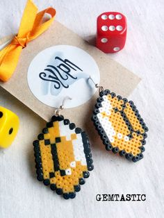 Simple but geeky Zelda game inspired pixelated Gemtastic earrings in warm orange tone made of Hama Mini Perler Beads by SylphDesigns
