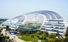 World largest solar powered building.  Shandong, China.  88% energy consumption reduction.  That is about 2640 tons of coal per year.
